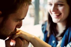 23-man-kissing-woman-hand-close-up